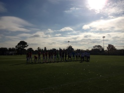 The two sides line up at the start of the game, in glorious sunshine